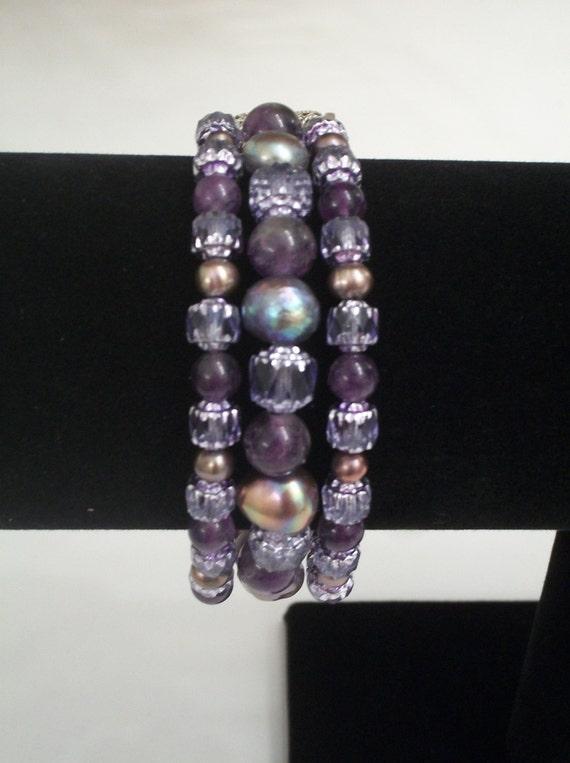 Triple Strand Amethyst, Freshwater Pearl and Crystal Bracelet.