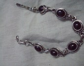 Silver Bracelet set with Garnet Cabochon very fine and excellent work 6 pieces of Garnet Cabochon are set with hook.beautiful bracelet