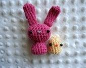Tiny pink amigurumi bunny and chick