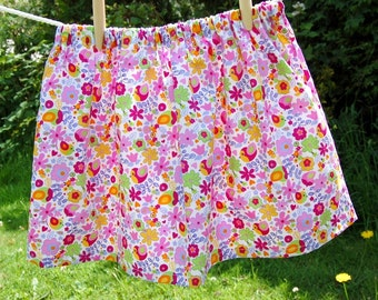 pink girls skirt multicoloured cerise green lilac yellow flowers and birds, age 4 -5  years UK