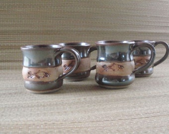 """Fish Mugs featuring a handmade impressed """"stamp"""" detailing the silhouette of a fish."""
