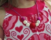 Lovestruck, customisable felt and wooden bead necklace, by NikoandNonnie