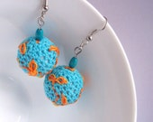 Turquoise crocheted dangle earrings orange embroidered branches and leaves ball earrings