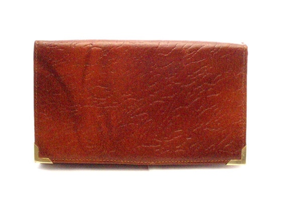 Vintage, Amber Brown Leather Wallet/Purse with goldtone edges on the front.