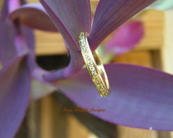 Natural yellow diamond eternity band by Kay Knight Designs