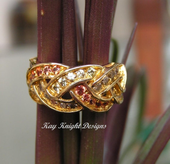 Orange and yellow sapphire and cognac diamond ring by Kay Knight