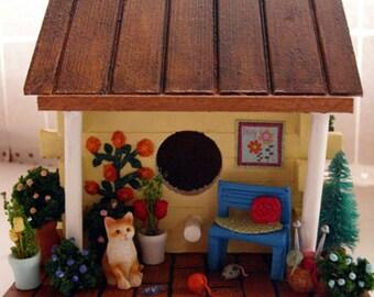 Yellow Birdhouse - Spring flowers, cat, yarn, knitting, windowbox, garden bench, cat toys, flowering vines, decorative birdhouse
