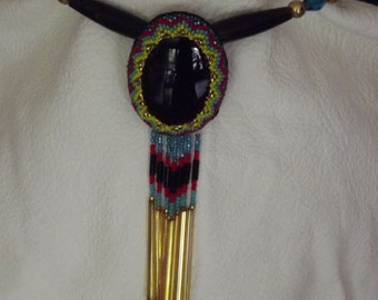 Beaded obsidian pendant with buffalo horn hairpipe, brass and cut glass turquoise beads