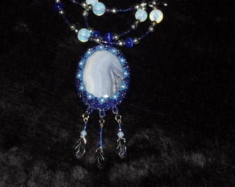 bluish white and clear agate with Czech-cut and antique beads and adjustable length