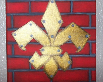 Golden Fleur-de-Lis on a Red Brick Wall