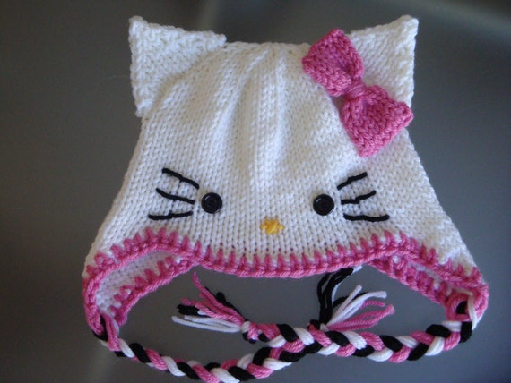 Knitting Pattern For Hello Kitty Sweater : Hello Kitty Hat with Earflaps and Pink Bow Newborn to Adult