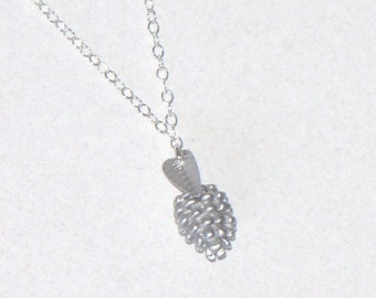 Pine cone and mini leaf sterling silver necklace, free of adding birth stone. A touch of nature within reach.