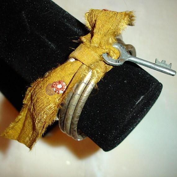 Silver Bracelets: Indian Jewelry Bangle Set with Mustard Yellow Sari Ribbon and Skeleton Key Jewellery