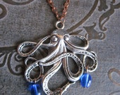 Sea Monster -- silver octopus necklace with blue glass water droplets on an antiqued copper chain