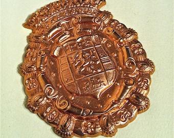Metal stamping of Royal Crest
