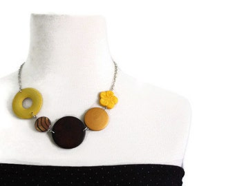 Chunky necklace in mustard yellow, brown and golden lake shells and wood beads.
