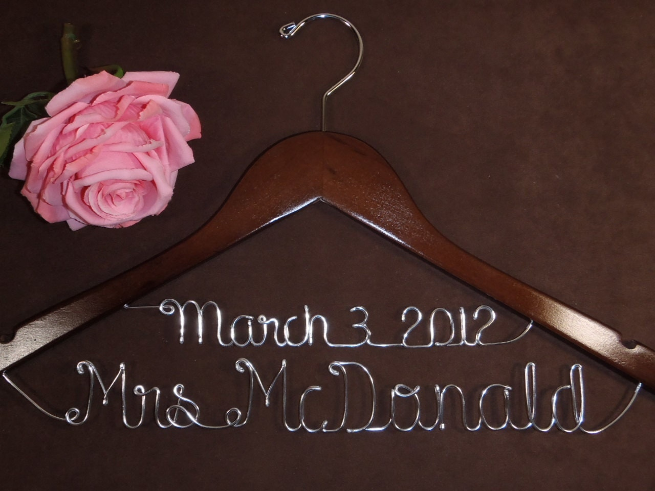 Unavailable listing on etsy for Personalized wire wedding dress hanger