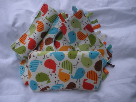 Wipes case and baby changing pad gift set with matching bib, burp cloth and ribbon taggie in Urban Zoologie Bermuda Birds