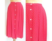 RESERVED    Farah Khaizurann UK 12 US 8   M-L    Red and white polka dot pleated skirt with buttoned opening