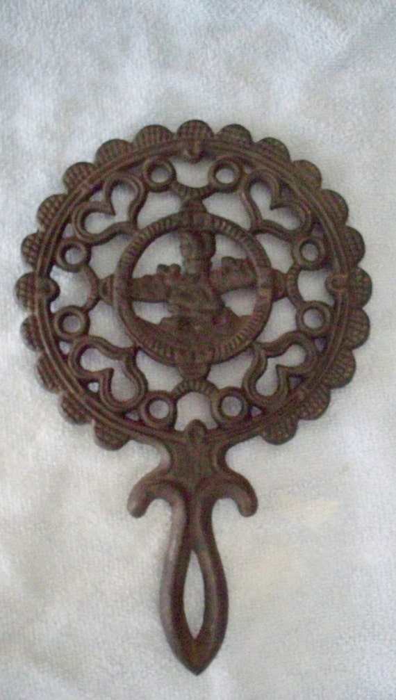 Vintage Cast Iron Trivet Iron Art, Hearts and Amish or Dutch Woman, Round With Pie Crust Design