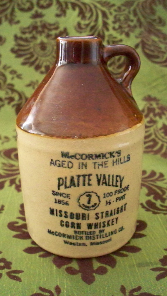 McCormicks Stoneware Whiskey Jug  Platte Valley Corn Whiskey 1/2 Pint