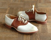 r e s e r v e d   vintage 1940s saddle shoes / deadstock brown and white saddle shoes / size 9