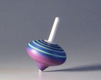 Purple, Pink, & Turqouise striped spinning top - turnip shaped