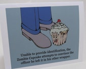Busted Zombie Cupcake Tries to Evade Capture Greeting Card