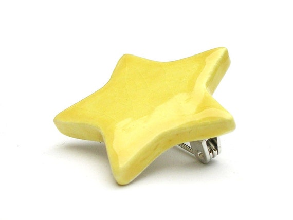 Bright yellow star ceramic button badge - handmade