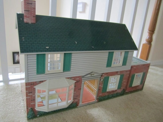 Marx Colonial Style Tin Doll House with sliding windows and beautiful graphics metal