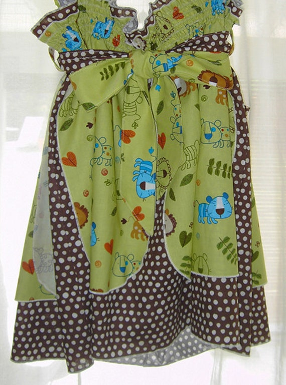 Childs Size 6  pinafore, baby Lions, Tigers and Polka-dots, Oh My.