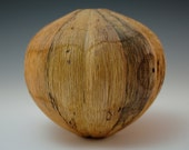 Carved and textured red oak hollow form