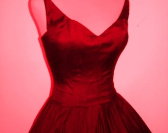 Beautiful 50s inspired red dress with detachable straps. Can be made to measure