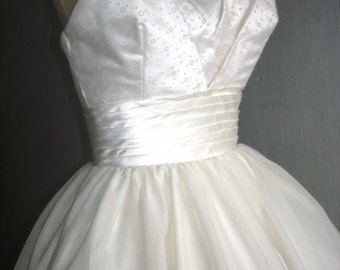 50s inspired ball dress with beautiful bust detail. Can be made to measure. All sizes welcome.