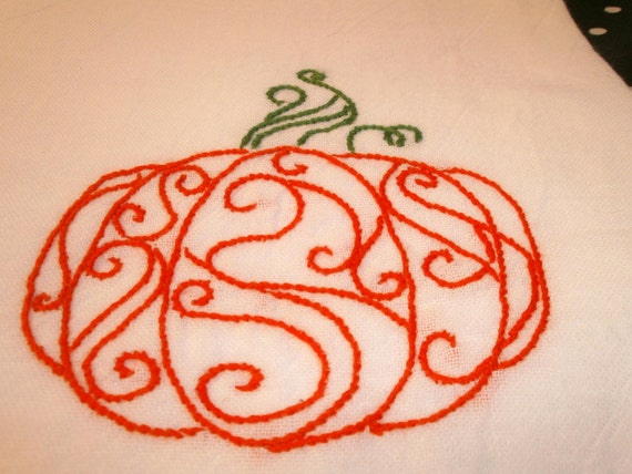 Hand embroidered swirly pumpkin dish towel