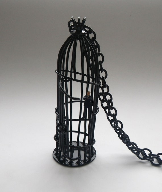 large bird cage pendant with tiny business man, gloss black, wire cage on long chain, powdercoat pendant