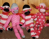 pink striped and polka-dotted sock monkeys