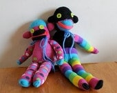 striped and polka-dotted sock monkeys