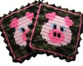 Crochet Pig Pot Holders. Pink pigs on green camouflage. Animal potholders
