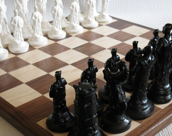 Chess set.  Solid wood chess board with Viking fiber cast chess set.