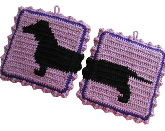 Dachshund Pot Holders. Orchid crochet potholders with black dachshund dog.