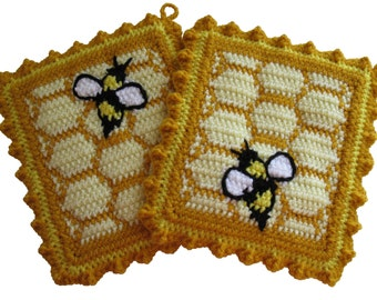 Honeycomb Pot Holders with Honey Bees.  Crochet bumblebee potholders.  Beehive trivet.