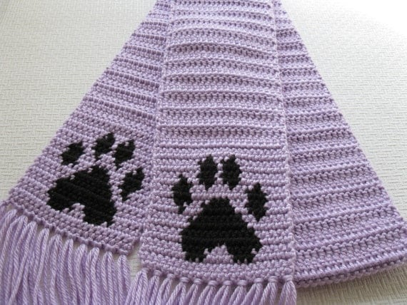 Free Crochet Pattern For Paw Print : Dog Paw Print Scarf. Long pastel purple crochet scarf with