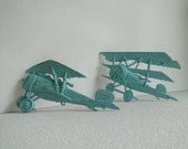 Vintage metal Airplanes painted in an aqua blue for nursery little boys room or dads office