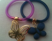 Blue and Purple rubber bracelets with Butterfly Charms