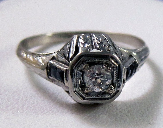 HOLDING --Art Deco Antique 18k .26 carat Old European Cut Diamond and Four Baguette Sapphire Ring