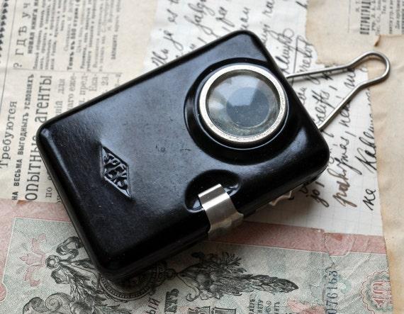 Vintage metal pocket flashlight.