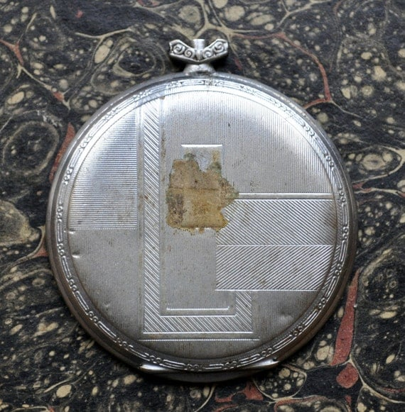 Antique pocket watch case.