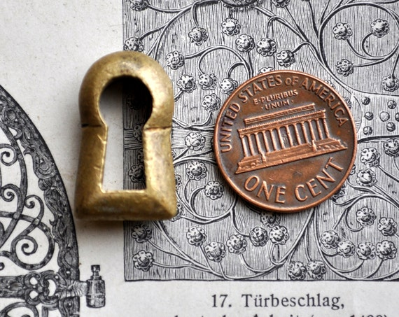 Vintage small brass key hole plate,escutcheon.