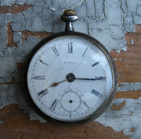 Antique pocket watch case with movement and dial.La Rochette.